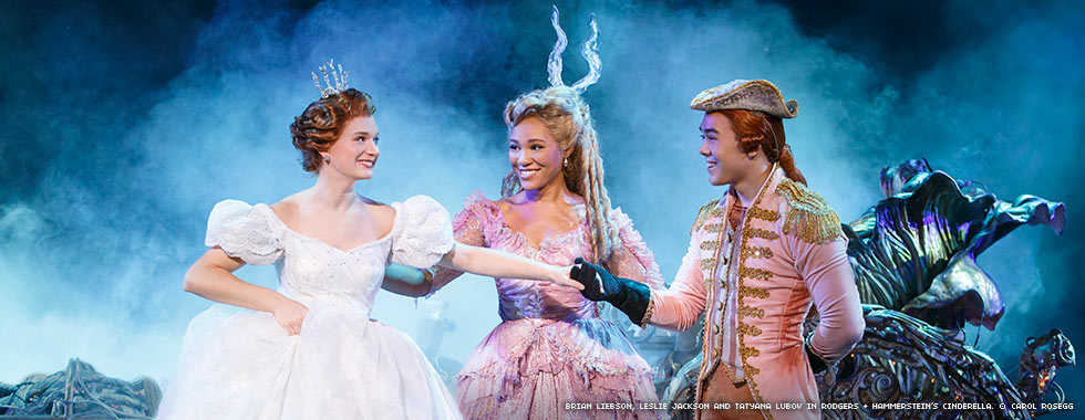 Cinderella smiles as her Fairy Godmother introduces her to her chariot driver.