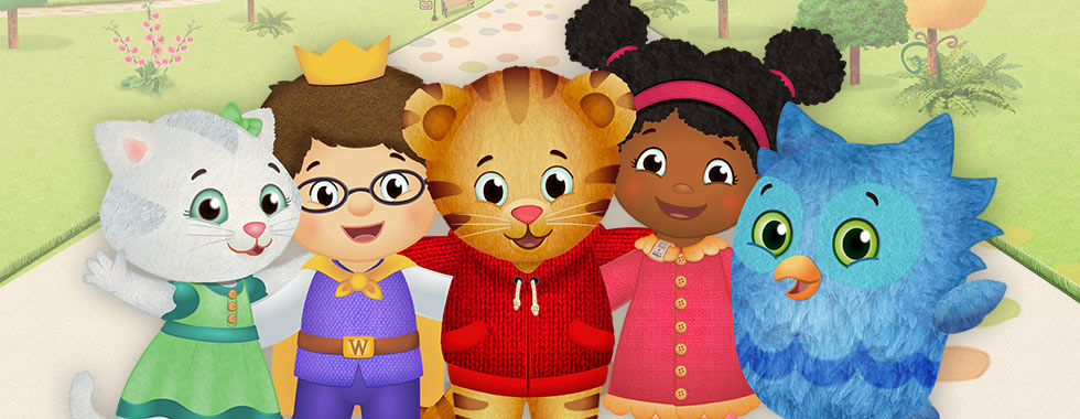 """Daniel Tiger, standing on a park sidewalk, is surrounded by his friends Katerina Kittycat, Prince Wednesday, Miss Elaina, and O the Owl in a promotional illustration from the PBS kids' show """"Daniel Tiger's Neighborhood."""""""
