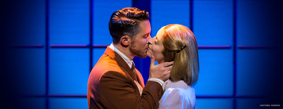Captain von Trapp embraces Maria with a kiss in a moment of passion.