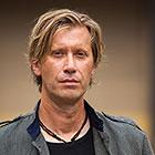 A headshot of drummer Tommy Igoe