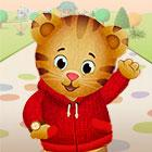 """Daniel Tiger, dressed in a zippered cardigan and wearing a watch on his right paw, waves hello in an illustration for """"Daniel Tiger's Neighborhood."""""""