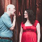 A male singer on the left sticks his tongue out at a female singer on the right in a promotional photo for vocal ensemble Roomful of Teeth.
