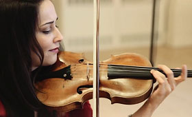 A close-up of Karla Donehew-Perez playing the violin.