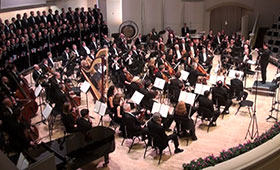 The entire orchestra performs on stage.