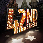 A showbiz-inspired light display spells out 42nd Street while a cityscape behind the words depict New York City.