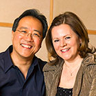 Yo-Yo Ma and Kathryn Stott smile.