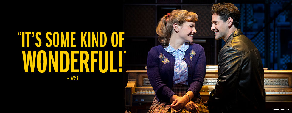 """""""It's some kind of wonderful"""" - NY1. A young woman smiles at a grinning young man sitting beside her at a piano."""