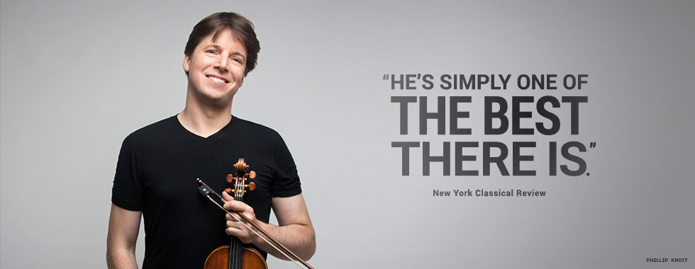 "A man smiling and with his head cocked slightly down to the left holds a violin and bow in his left hand. ""He's simply one of the best there is."" New York Classical Review"