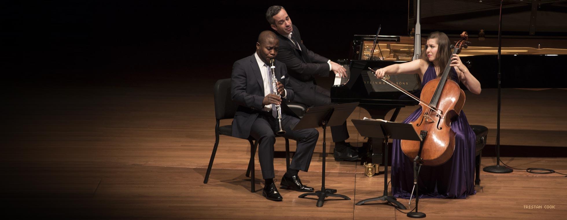 Clarinetist AnthonyMcGill, pianist Inon Barnatan, and cellist Alisa Weilerstein perform on stage.