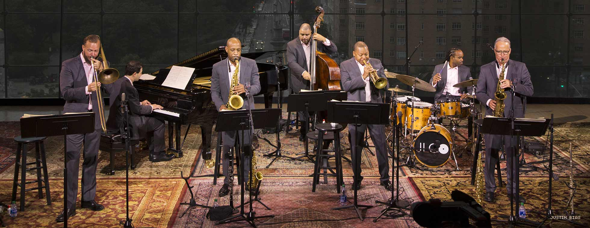 Wynton Marsalis and members of the septet perform in front of a window that overlooks Manhattan.