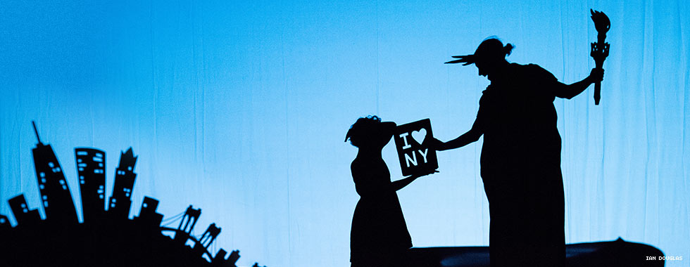 "The silhouette of dancers depicting a young girl and the Statue of Liberty hold an ""I Heart New York"" sign in Pilobolus' ""Shadowland."""