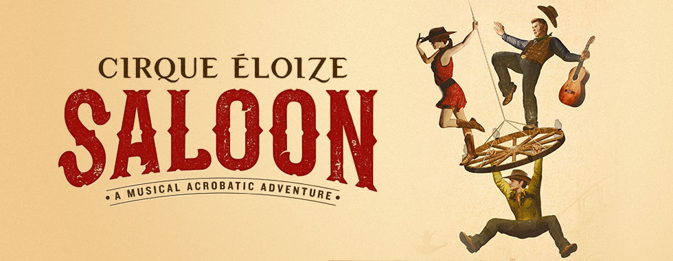 "A cowgirl and guitarist balance atop a wagon wheel while a cowboy hangs from the wheel in an illustration highlighting ""Saloon, A Musical Acrobatic Adventure."""