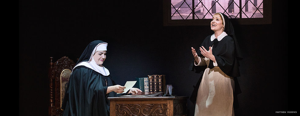 Maria speaks to an appreciative Mother Abbess sitting at her desk at the abbey.