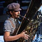 "A musician from Darcy James Argue's Secret Society wears early twentieth-century period dress and plays a tuba in a performance of ""Brooklyn Babylon."""