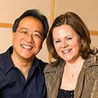 Yo-Yo Ma and Kathryn Stott smile.