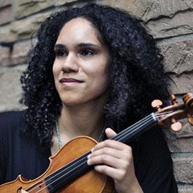 Jessie Montgomery holds her violin.