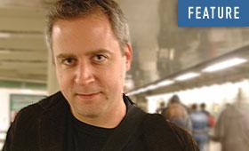 Photo of Jeremy Denk walking through a subway station.