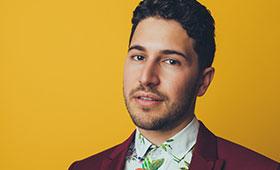 Emmet Cohen smiles in a portrait.