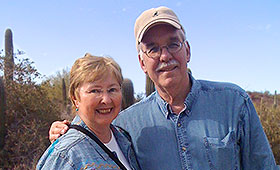 Patricia Best and her husband Tom stand together in the desert.