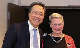 Yo-Yo Ma and Litzinger stand together and smile for the camera.