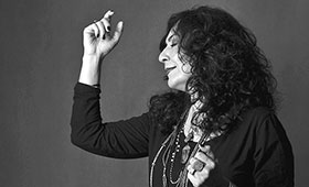 Singer Mahsa Vahdat dances as she sings.