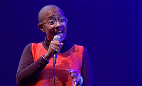 Singer Cecile McLorin Salvant sings into a microphone.