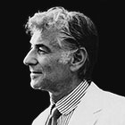 Leonard Bernstein is shown in profile from the shoulders up.