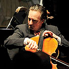 David Finckel plays the cello on stage.