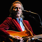 Lightfoot plays the guitar.