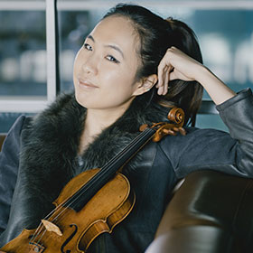 Danbi Um holds her violin.